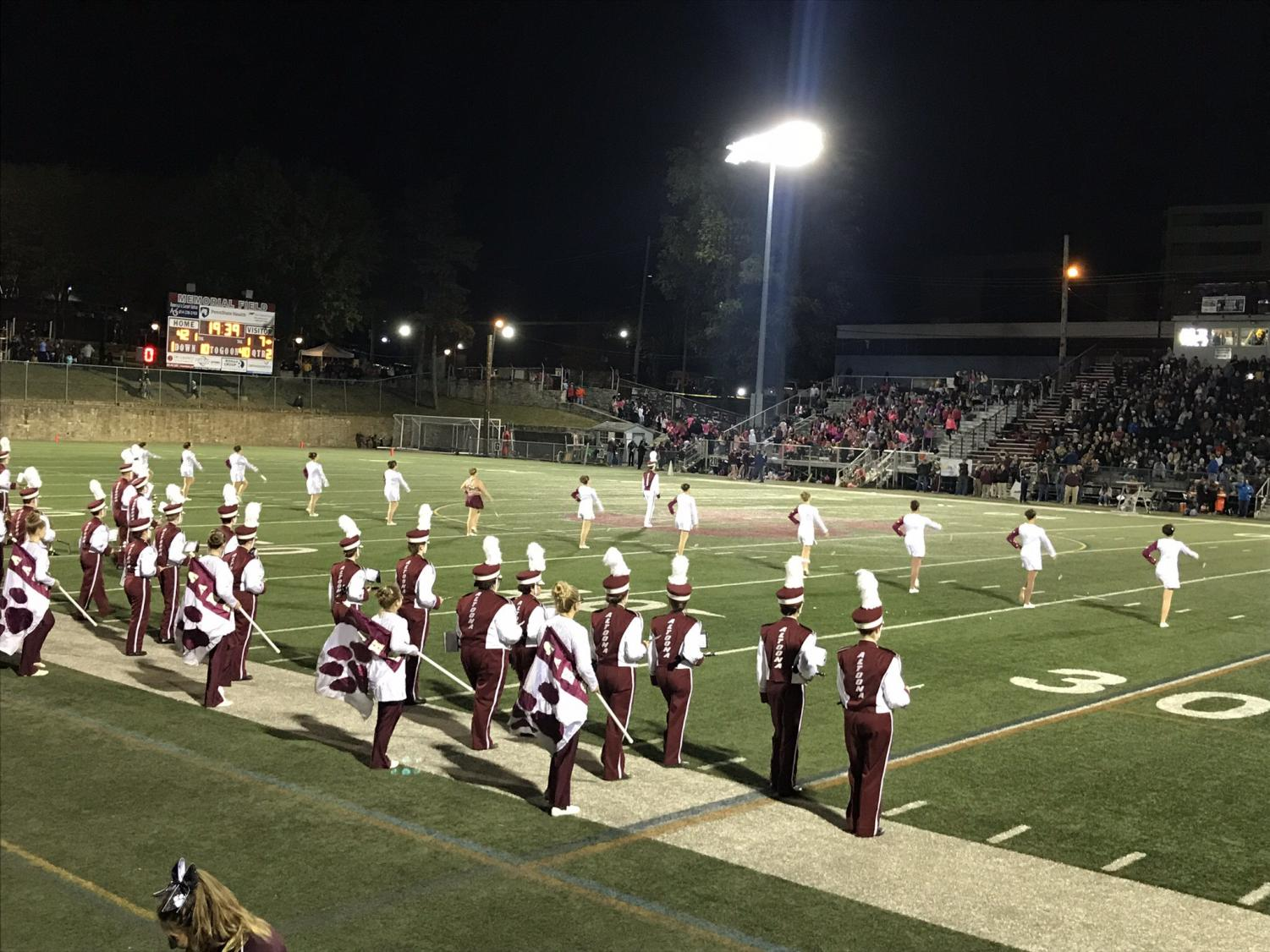Lets go lions! The Altoona High School marching band starts their half-time performance by marching out onto the field. AAHS attended their last game at State College on Oct. 19 during this year.