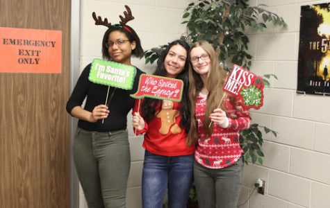 Say Cheese! Seniors Vydalia Weatherly, April Silva and Hannah Roesch spreads holiday cheer to the community at last year's holiday Christmas party held by the Student Council club. This year Student Council will travel to Garvey Manor nursing home to spread holiday cheer to senior citizens.