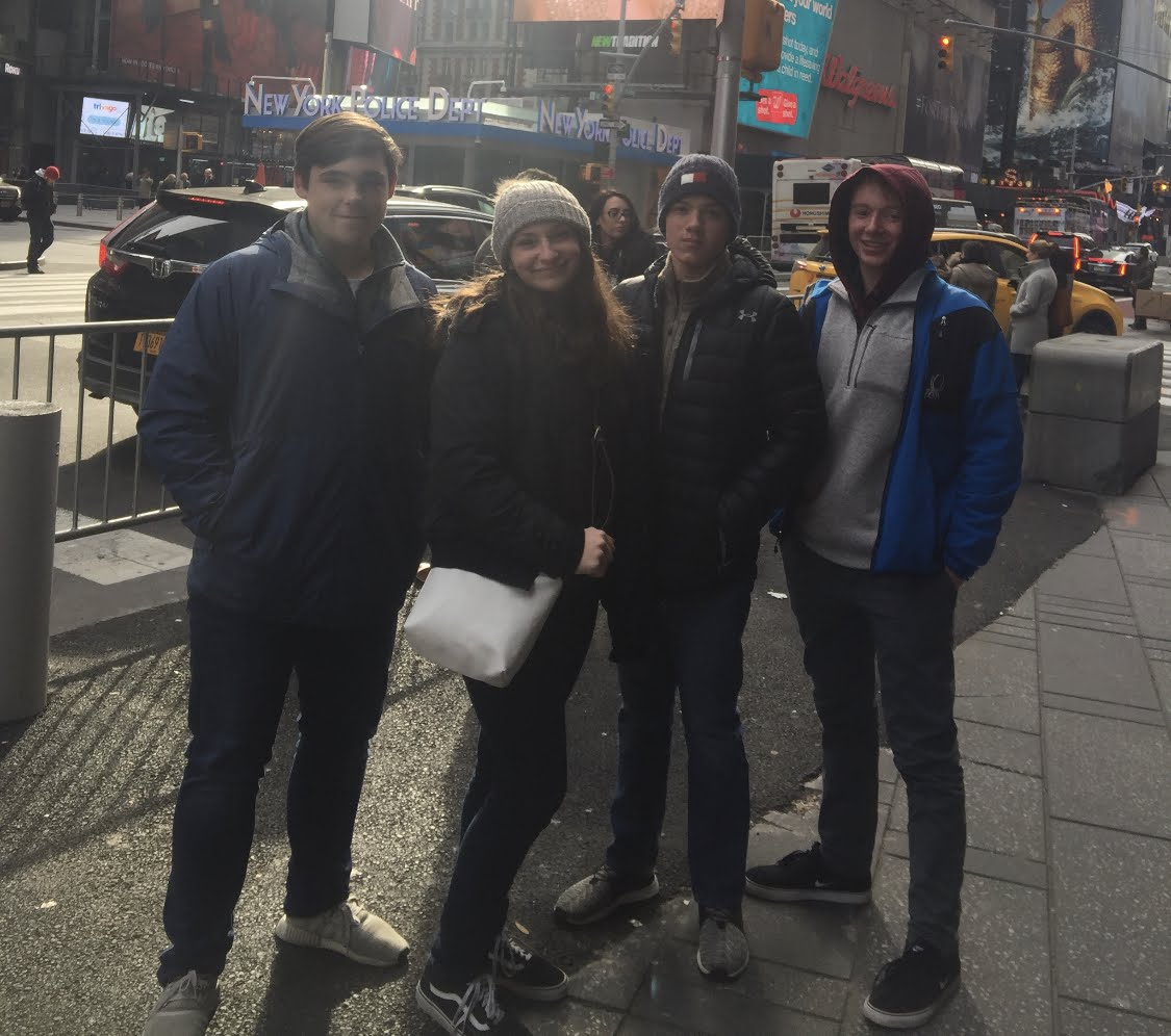 Say cheese! Ben Blackie, Sophia Roefaro, Matt Bowser and Kyle Murray pose for a photo in Time Square. Blackie, Roefaro, Bowser and Murray explored Time Square together after the picture was taken.