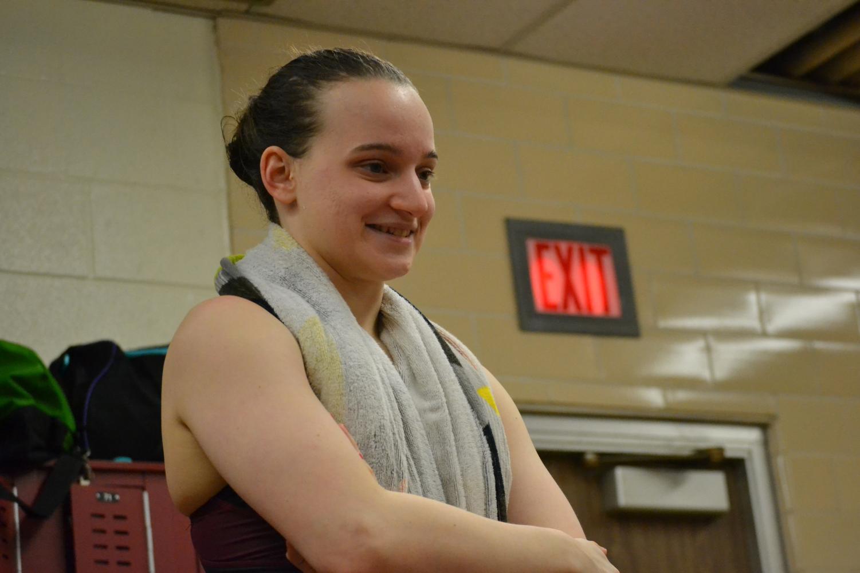 Senior+Iris+Kauffman+gives+the+girls+a+motivational+speech+in+the+locker+room+before+the+meet.+