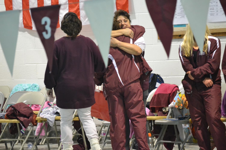 Coach+Nanette+Cummings+hugs+senior+Christina+Brunette+as+she+walks+down+the+pool+deck.+