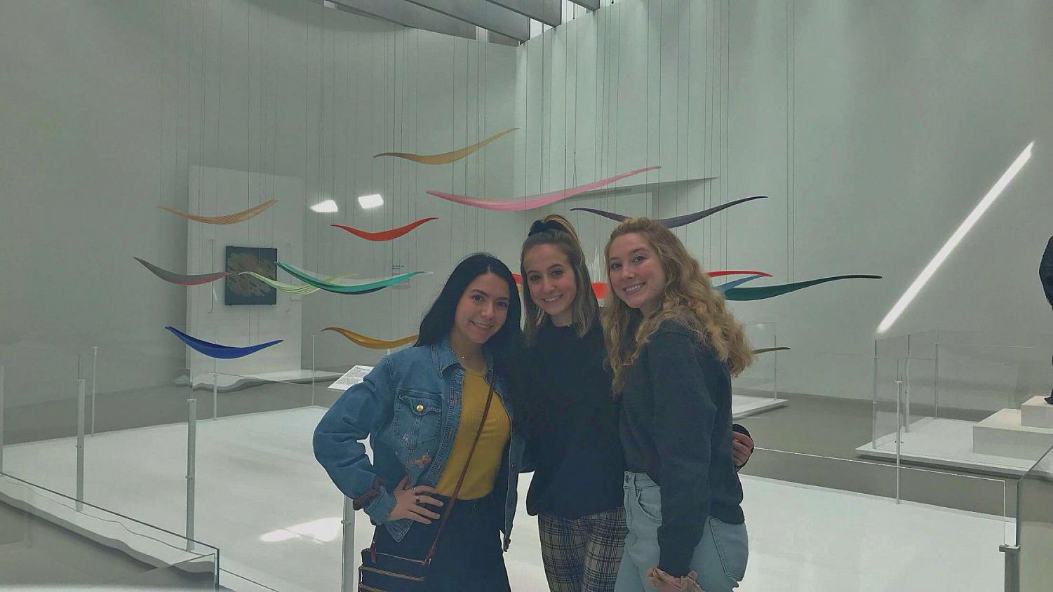Experimenting with glass blowing. Junior April Silvia, sophomore Grazia Macharola and junior Paige Glasgow pose for a picture at the Corning Museum in New York. The National Art Honor Society traveled to the museum on Wednesday, April 17.