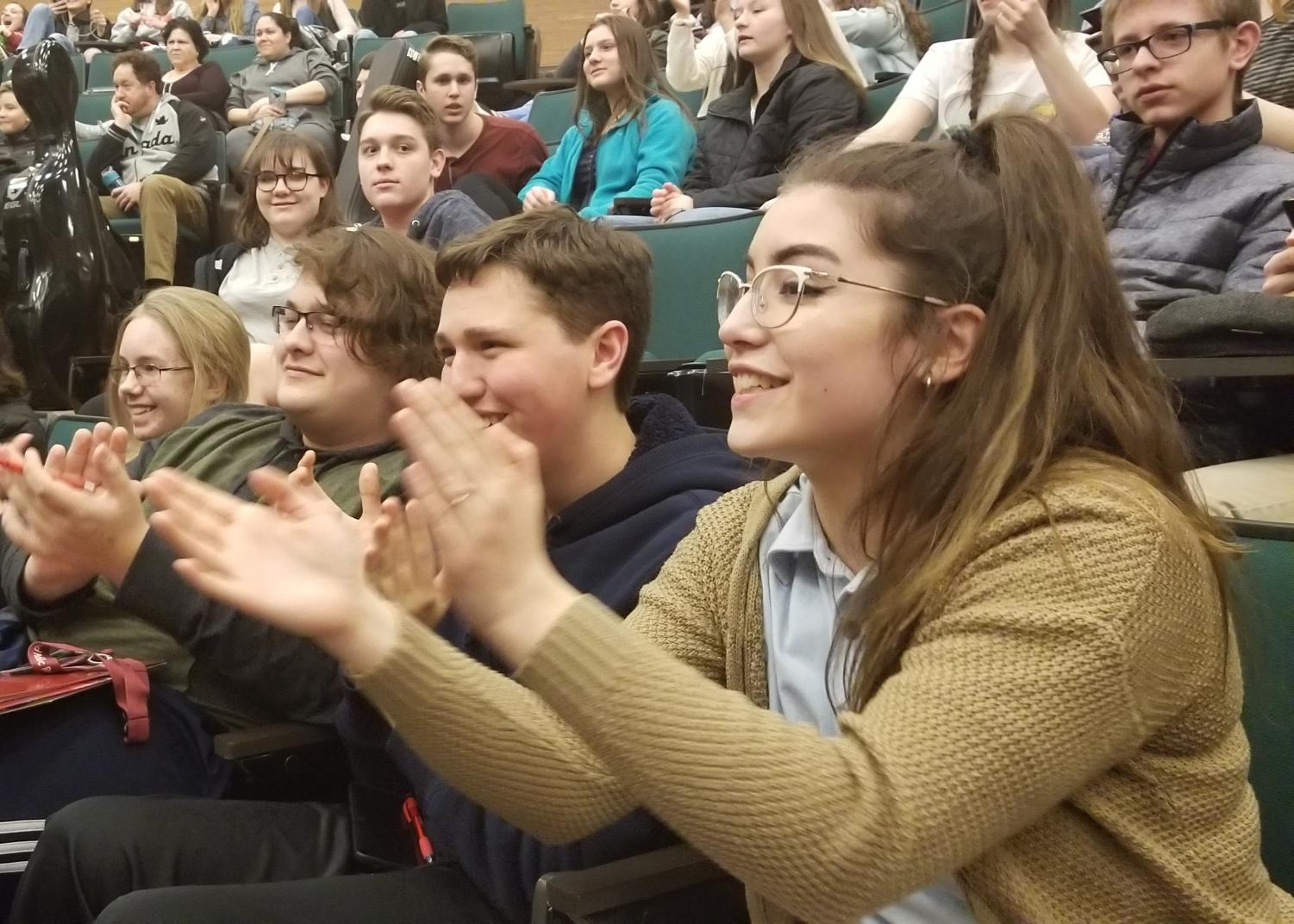 Senior Nathalia Daversa, sophomore Alex Thaler, sophomore Aiden Phillips and sophomore Joshua Terza clap during the awards ceremony. Around 35 students from Altoona placed.