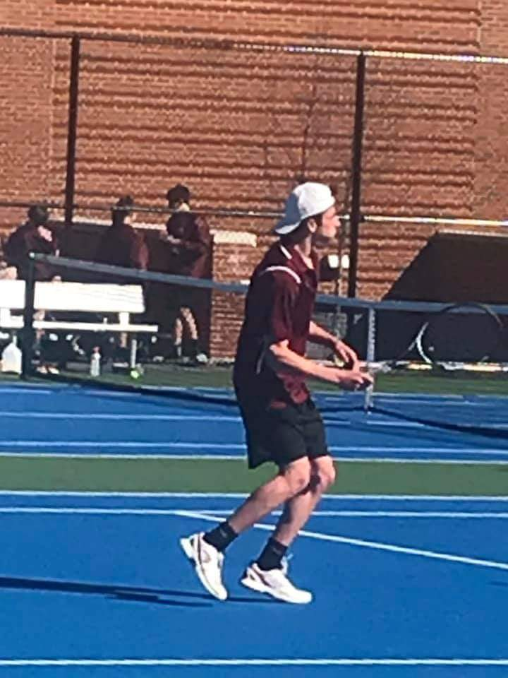 Hit! Casey Rispoli competes in a recent spring tennis match. The boys' tennis team will be competing and hosting in the Mt. Lion Classic.