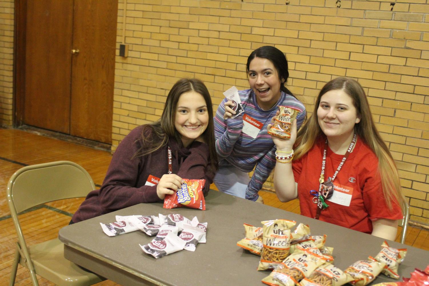 Pick+a+Snack%21+Juniors+Grace+Osmolinski%2C+April+Silva+and+Elizabeth+Strunk+smile+and+pose+with+a+snack+that+was+out+on+the+table+for+the+students%27+giving+blood.+Students+who+gave+blood+were+given+the+option+to+chose+raisins%2C+pretzels%2C+oreo%27s+and+cheez-its.+