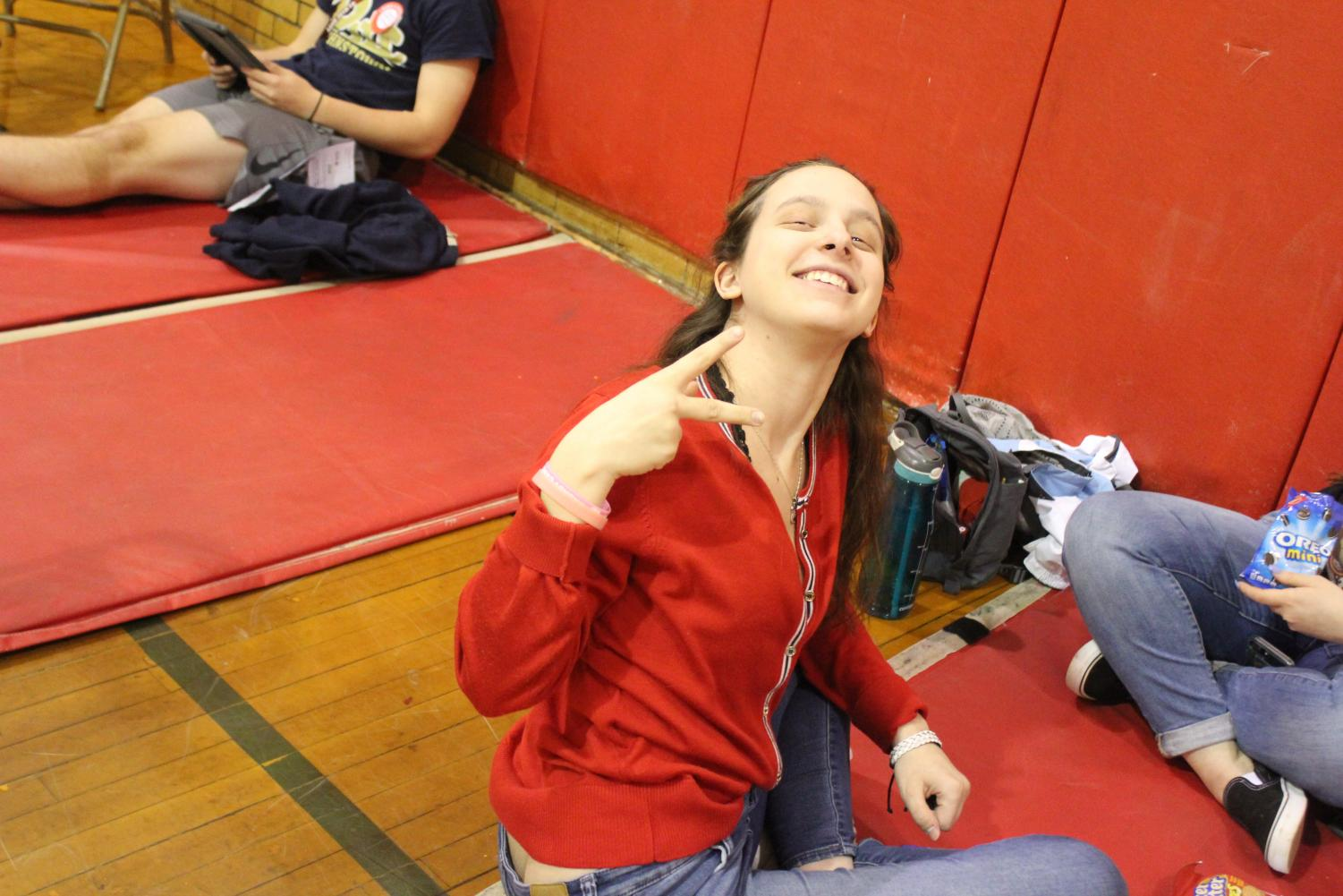 Senior+Kristine+Kyle+gives+out+a+peace+sign+while+waiting+to+get+called+to+donate+her+blood.+