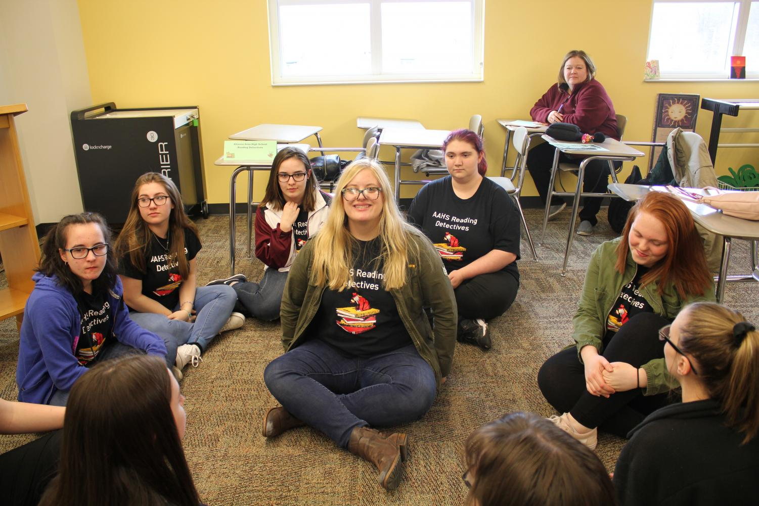 Circle+time.%0ASenior+Kaitlyn+Clouser+smiles+widely+at+the+camera+as+she+sits+in+the+middle+of+the+small+reading+team+circle.+Clouser+is+the+reading+team+student+leader.