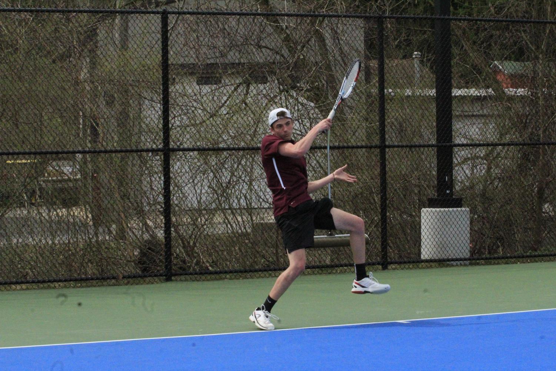 Senior+Casey+Raspoli+returns+a+serve+to+his+Holidaysburg+opponent.+