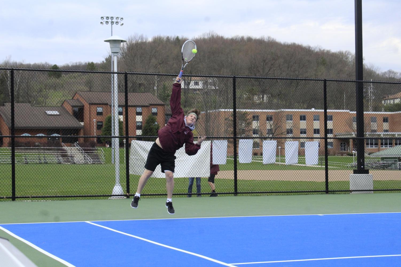 Senior+Jonah+Brandt+serves+a+ball+to+his+Hollidaysburg+opponent.+