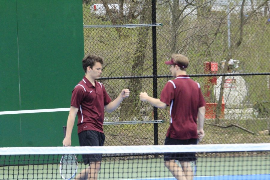 Senior+Tyler+Robinson+and+Junior+Colby+Bickel+first+bump+after+winning+a+doubles+set+against+Hollidaysburg+.