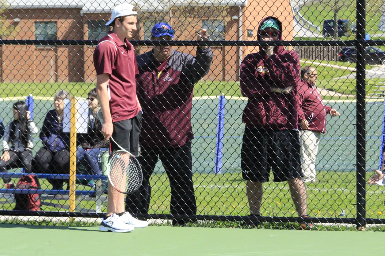 Senior+Casey+Raspoli+talks+to+Coach+Eric+Hovan+about+the+set+he+previously++played.+
