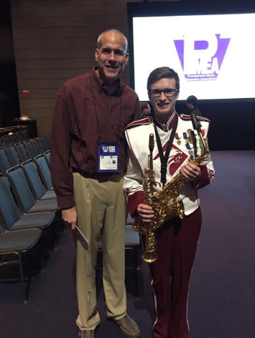 A round of applause for the musicians. Senior Ian Brannan and band director Larry Detwiler pose for a picture in celebration of the festival. From April 3 to April 6, selected musicians participated in the PMEA all-state music festival in Pittsburgh.
