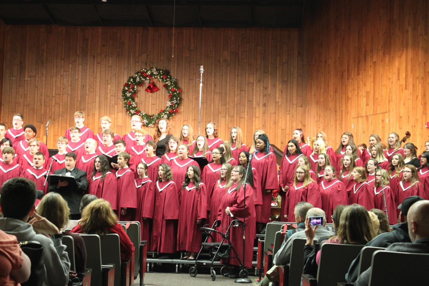 The concert chorus give it their all as they sing the last song of the night. In the high school auditorium, chorus students performed holiday hits in the holiday chorus concert.