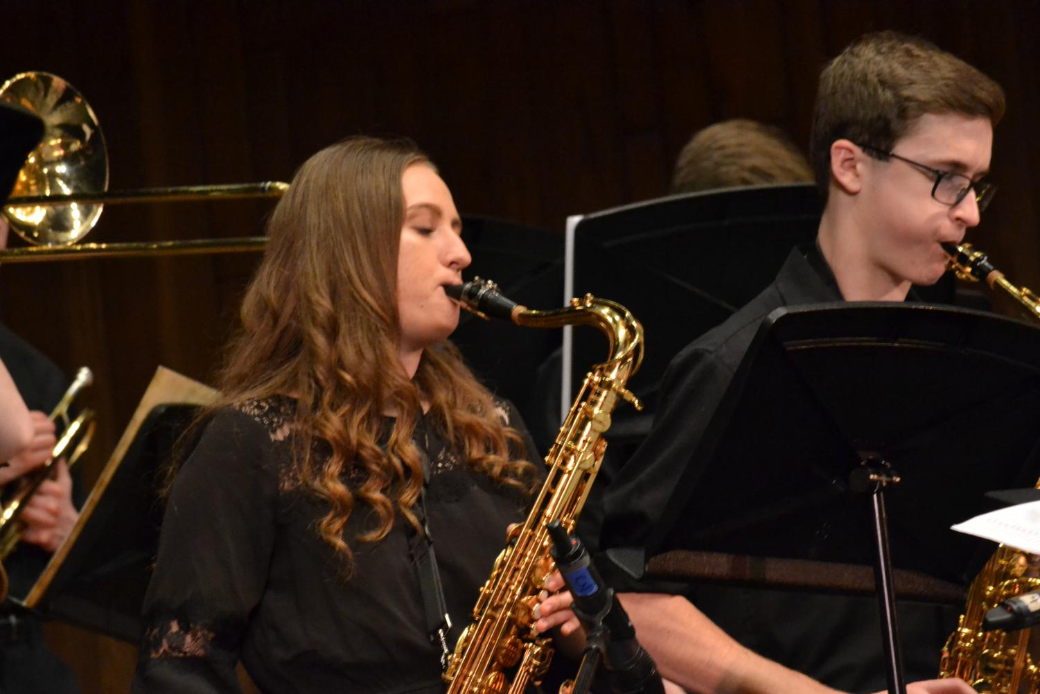 Seniors Morgan Fleck and Ian Brannan play their hearts out blowing into their tenor saxophones.