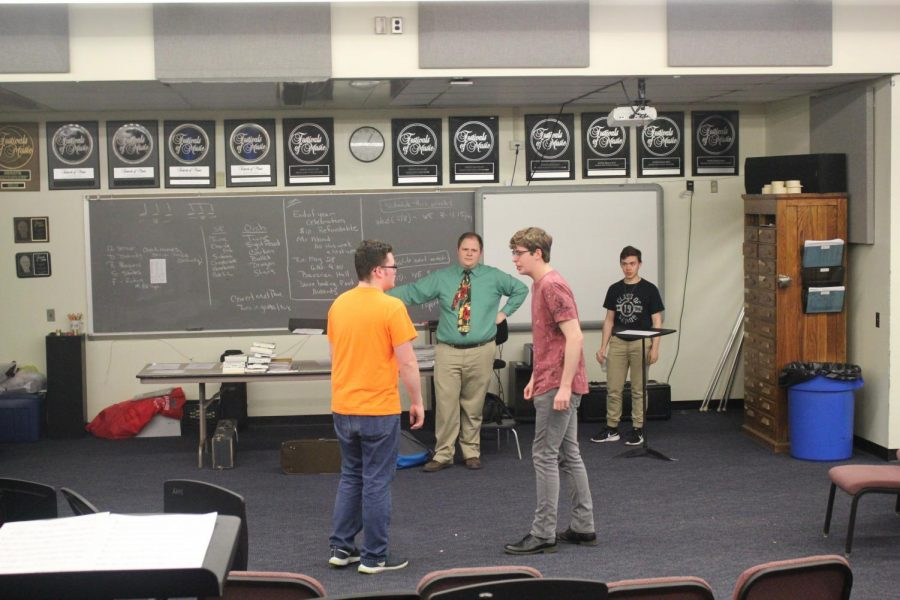 Practice+makes+perfect.%0AJunior+Jarrett+Hann+and+senior+Christian+Howard+prepare+for+the+Isaacs+by+practicing+one+of+their+musical+numbers+from+the+play.+Drama+adviser+and+play+director+Ben+Cossitor+observes+them+as+he+adds+notes+to+help+with+the+upcoming+performance.+