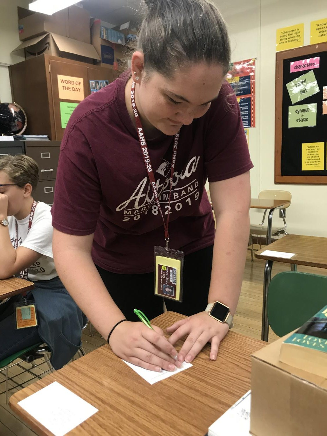 Junior Kelly Biddle votes for class president. The ballots were handed in directly after students voted, and officers were announced during seventh period.