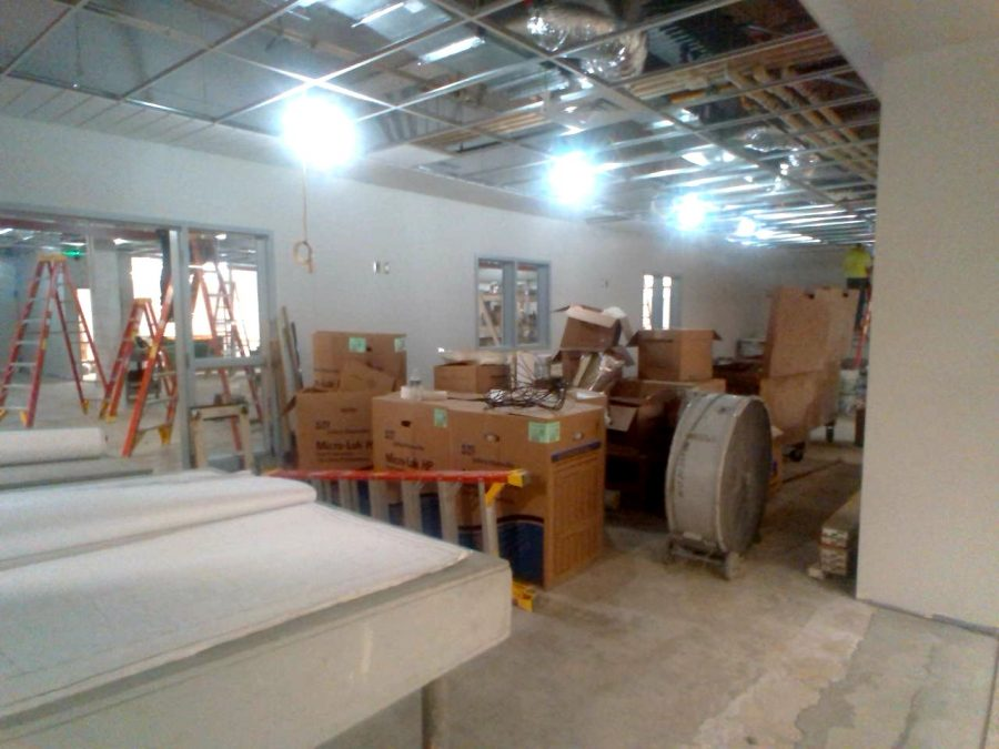 Constructions+crews+continue+their+work+in+the+A+building+pushing+toward+and+October+completion+date+for+the+library.
