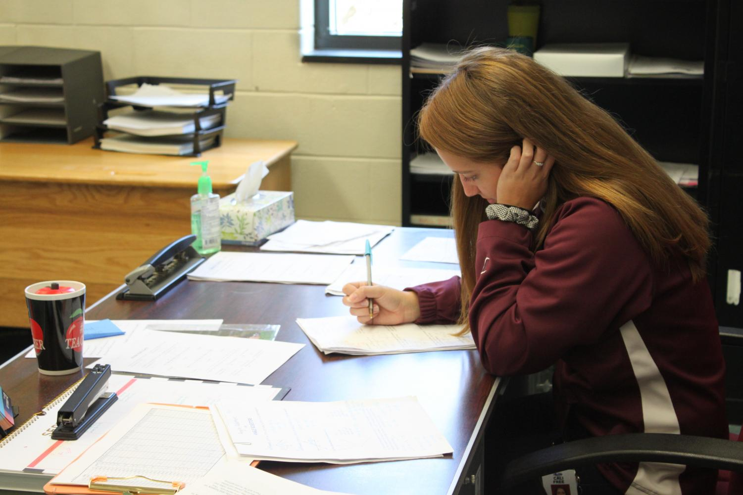 Cali Free grades papers and settles into her new teaching job.  This is her first teaching job here at Altoona High, and the Mountain Lions have welcomed her with open arms.