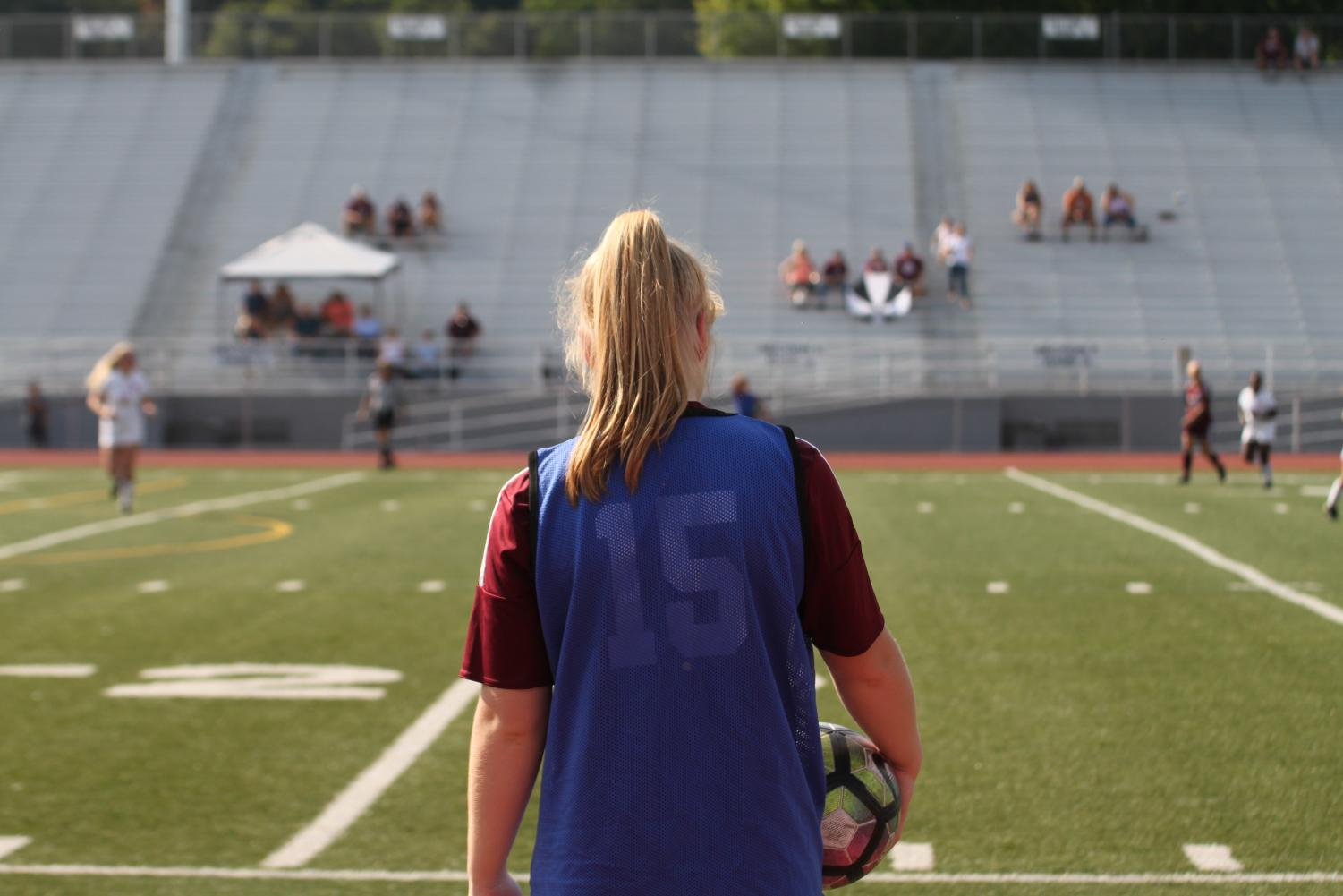 The game begins. On Saturday, Sept. 21, sophomore Rebecca Dull watches closely as her team fights for the ball against Williamsport. The game started at 3 p.m., at Baker Mansion.