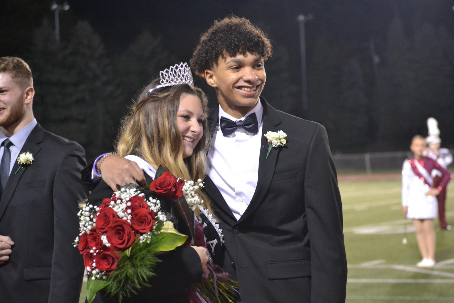 Kassidy Duclos and her escort, KJ Futrell, smile after winning Homecoming Queen. Duclos represented FBLA.