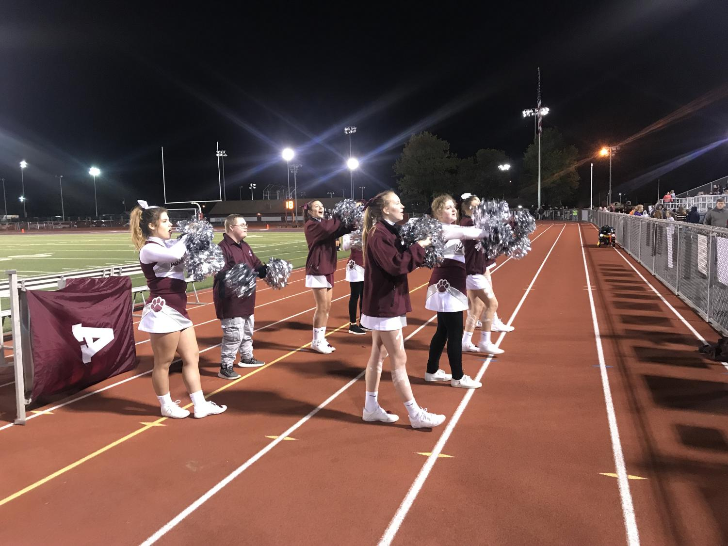 Let's go lions! The varsity cheerleaders help the other Sparkle kids during the Friday night football game. The girls cheered until halftime then went back to varsity.