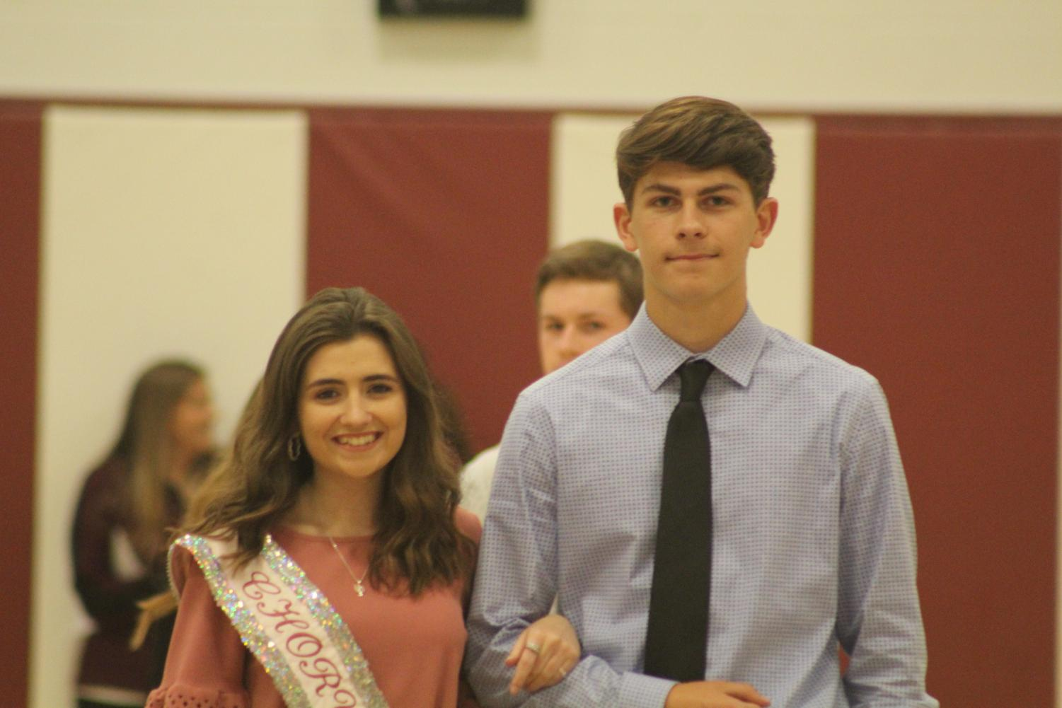 Senior Raquel Dunio and her escort, senior Wesley Young, represent chorus at the Homecoming assembly. At the assembly, candidates were introduced to the student body.