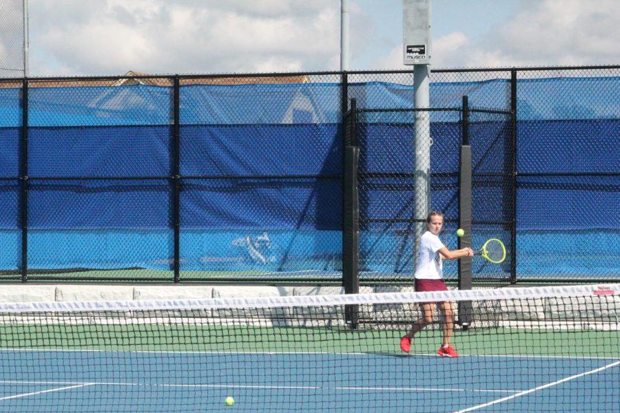 Ready+set+go.+Senior+Alese+Rinker+gets+ready+to+hit+the+ball+that+is+coming+towards+her.+Rinker+competed+against+freshman+Morgan+Stevens+in+the+District+Six+singles+championship+at+Mansion+Park.+