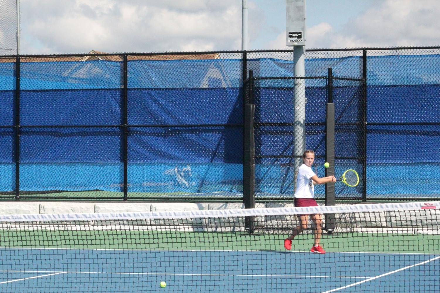 Ready set go. Senior Alese Rinker gets ready to hit the ball that is coming towards her. Rinker competed against freshman Morgan Stevens in the District Six singles championship at Mansion Park.