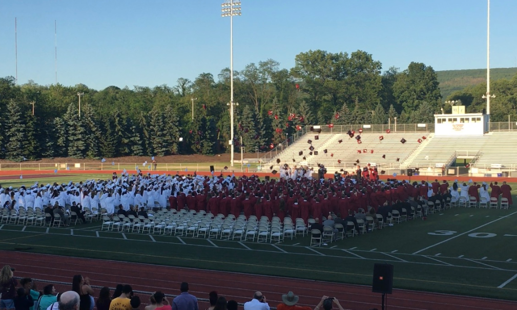 The graduating class of 2018 throws their caps into the air at the end of the ceremony. The Central PA Graduation Initiative is an aid for students who do not feel confident in graduating.