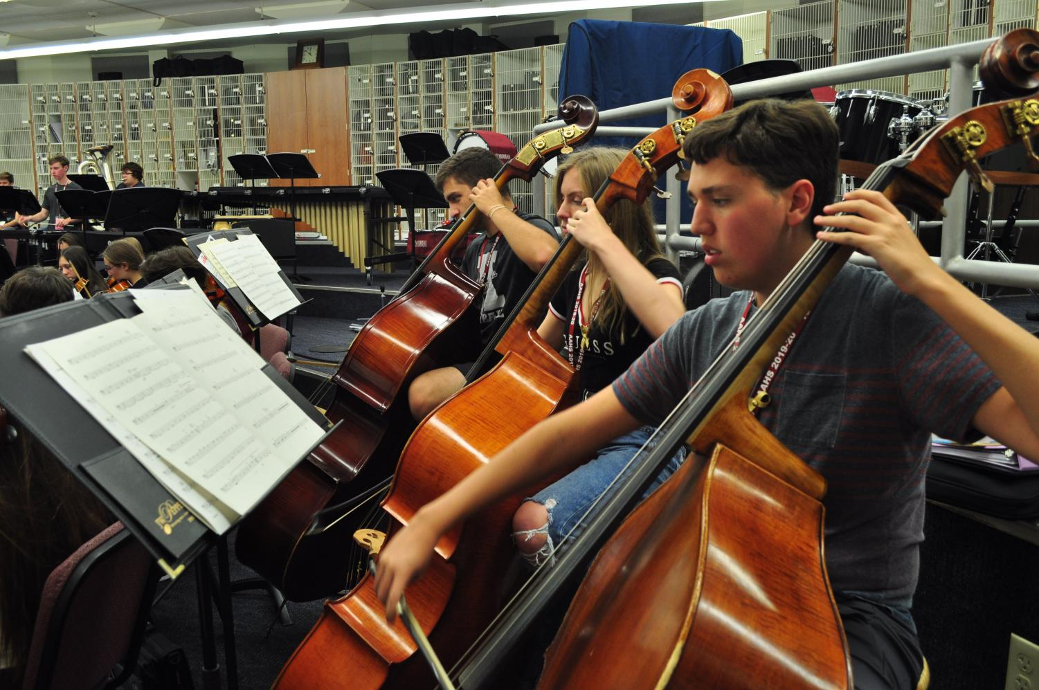 String music!  Junior Alex Thaler plays his bass during class. The orchestra is getting ready to play in the concert.