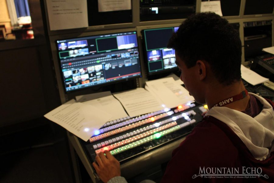 Sophomore+Brayden+Adams+manages+the+MLTV%27s+switching.+For+switching%2C+Adams+controls+the+images+and+videos+as+shown+on+the+television+screen+during+a+live+show.