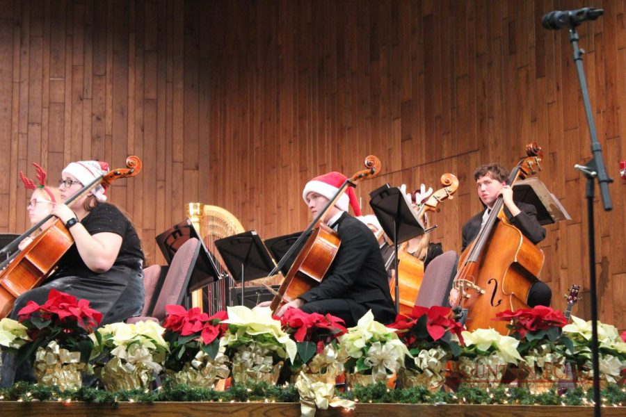 Joseph Estep gets ready for the next song during the short intermission. He played cello.