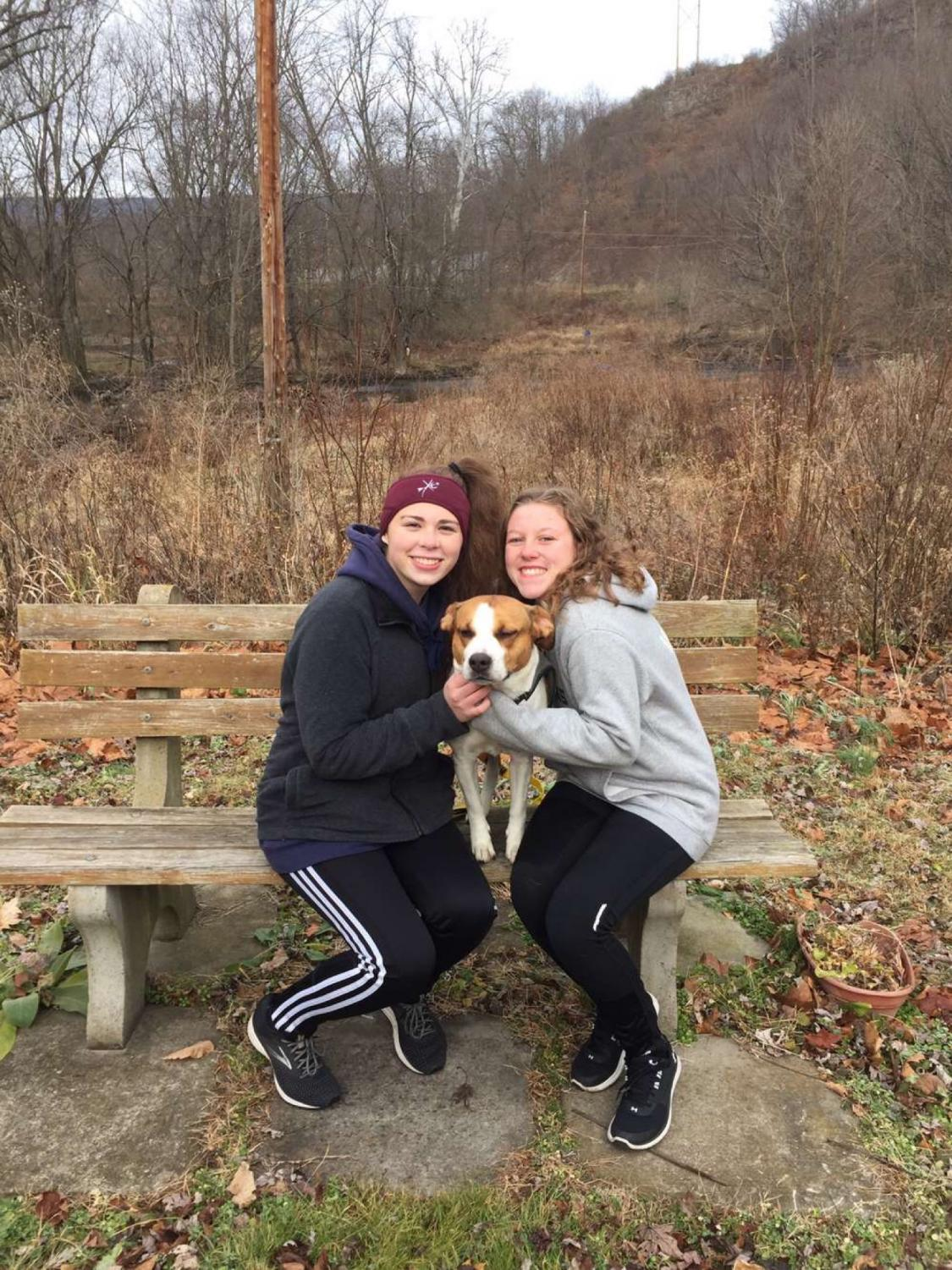 Good Dog! Senior Kylee Wisor smiles with project partner Emily Rentz. The two girls participated in Wisor's senior project