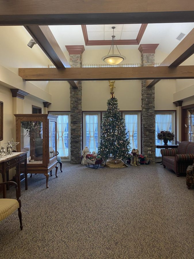 Many Christmas trees were set up throughout Garvey Manor. This one was located in the lobby. Before the Christmas party, members of the junior class executive committee walked the residents around the building to show them all of the trees.