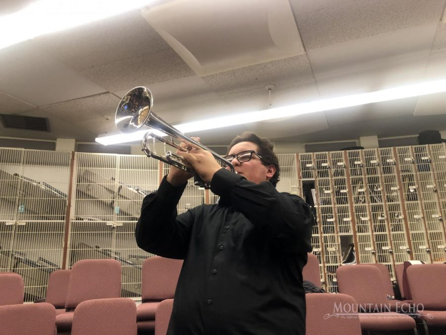 Play your heart out. Sophomore Lukas Caracciolo plays a couple of notes before heading out to perform. Caracciolo plays trumpet for the 'B' jazz band and for the wind ensemble.