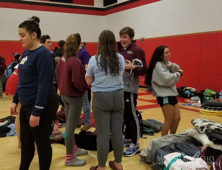 Members+of+the+teams+stand+in+the+gym+at+Clearfield+High+School+at+the+end+of+the+invitational.+After+the+invitational%2C+swimmers+got+pizza+to+eat+on+the+bus+ride+home.+