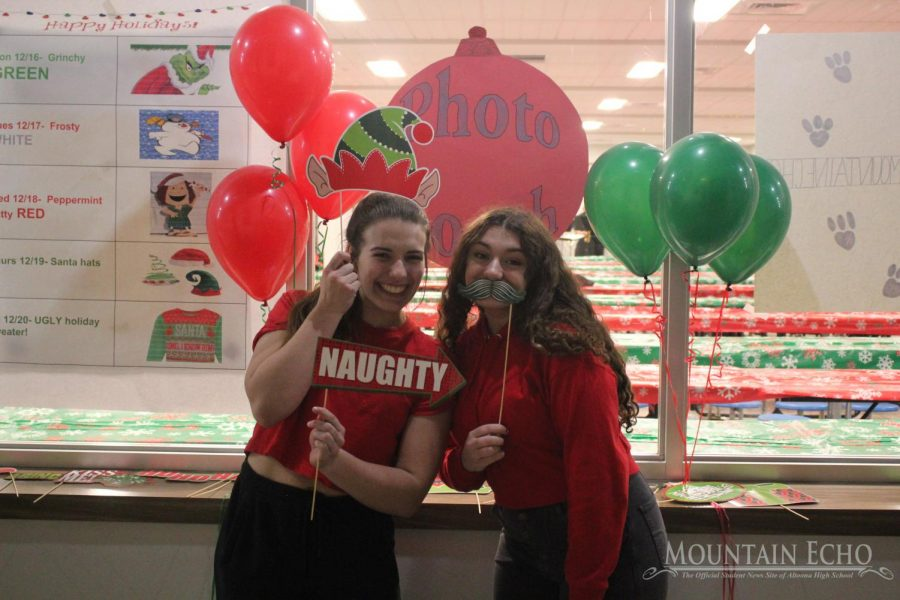 Sofia Veneziano and Macy Yost are working the photo booth.  There were many props to use in the pictures, and the guests enjoyed the photo booth all night.