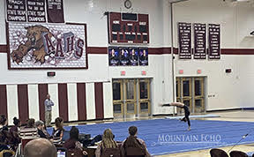 On the floor Marissa Stouffer competes with her floor routine Thursday Jan. 16.  Stouffer has been a gymnast for 15 years.