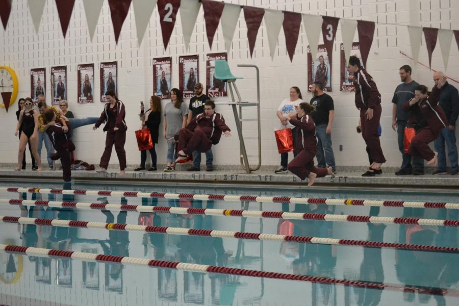 The+seniors+jump+into+the+pool+with+their+warm-ups+on%2C+a+tradition+for+the+swim+team.+%0A%22It+feels+so+weird+to+be+leaving+after+all+this+time.+But%2C+I%27m+excited+for+what+my+future+has+in+store+for+me%2C%22+senior+Anastasia+Slobodnik+said.+