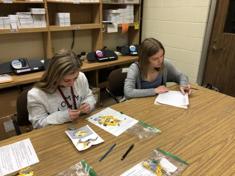 Junior Karenna Kauffman examines other junior, Cassie Kyle, who gets hard to work on her lego model. Kyle worked on her model in session one of Kauffmans expiriment.