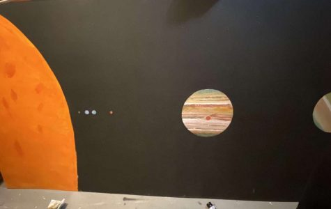 Stars and Galaxy Senior Allison Peterman creates a mural of the solar system for her senior project. Peterman chose this as her senior project because she wanted to give back to Astronomy teacher James Krug a gift for the planetarium.