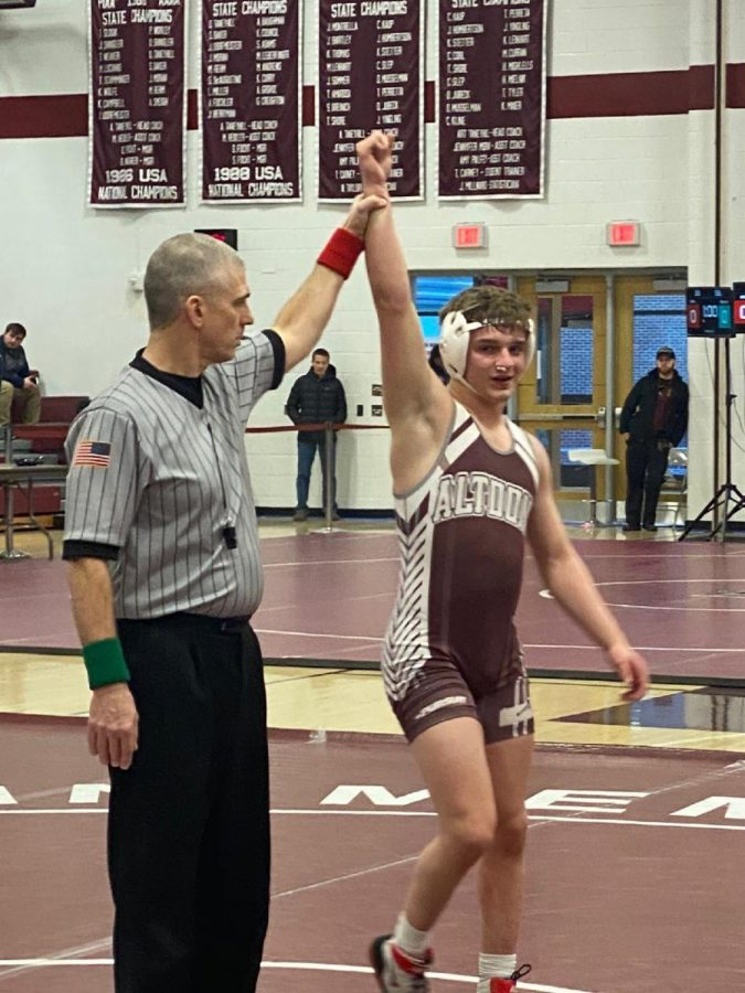 Standing tall.  Junior Matthew Sarbo stands tall after winning at districts. He finally reached his goal of 100 wins.