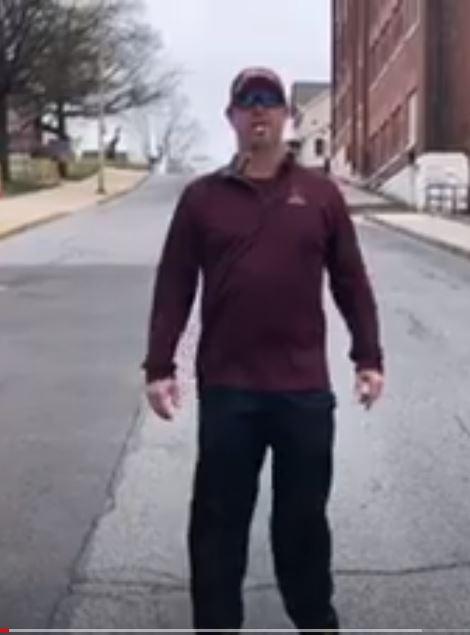 Softball coaches make video for team