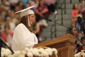 We did it! A 2019 senior gives a speech to her graduating class. This year a virtual graduation will be played on June 5 and a live commencement is planned for July 25.