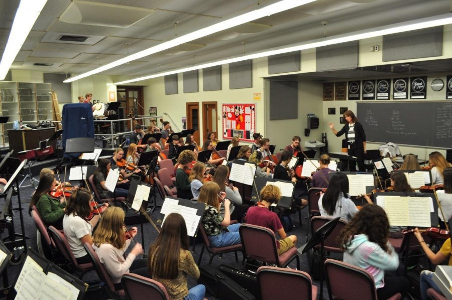 Kelly Detwiler directs the 2019-2020 orchestra. In person orchestra rehearsals will start Sept. 21.