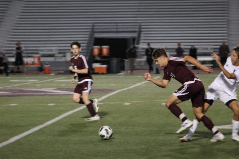 Run! Austin Kravetz runs for the ball during a 2019 soccer game. Kravetz then scored a goal.