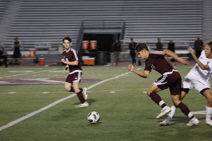 Run! Austin Kravetz runs for the ball during a 2019 soccer game. Kravetz then scored a goal.