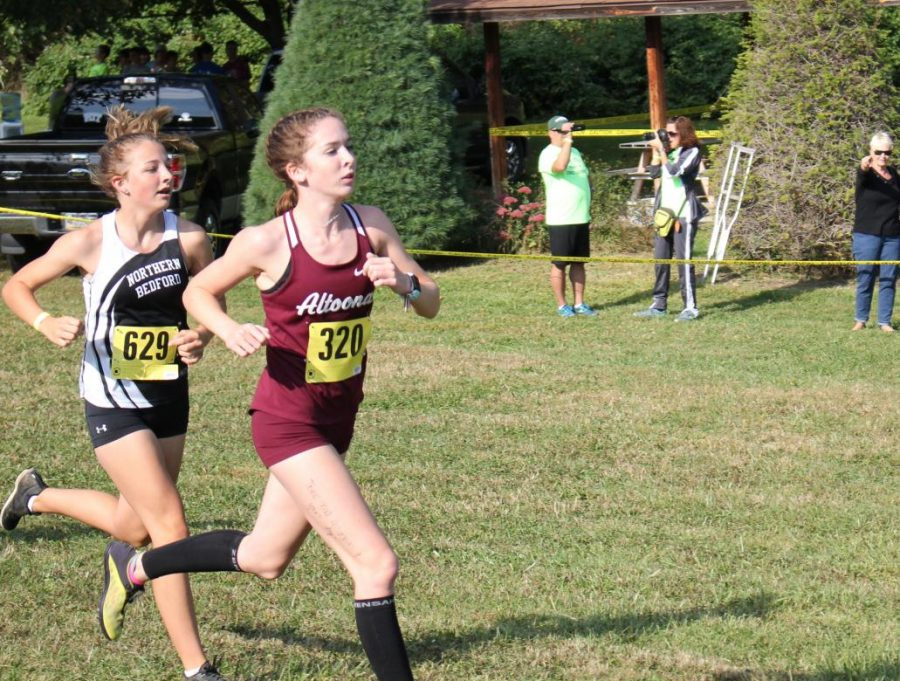 Junior Mackenzie Kelly runs in a 2019 Cross Country meet. This year there will be no spectators at the meets.
