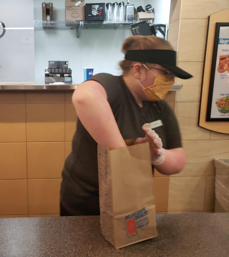 Gracie+Cowfer+get+people%27s+orders+ready.+She+was+behind+the+the+counter+to+help+get+an+order+at+Dairy+Queen.+