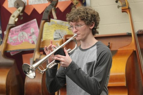 Senior Isaac Brumbaugh plays a mellow B natural and fits into the trumpet section. The jazz band is rehearsing for future performances.